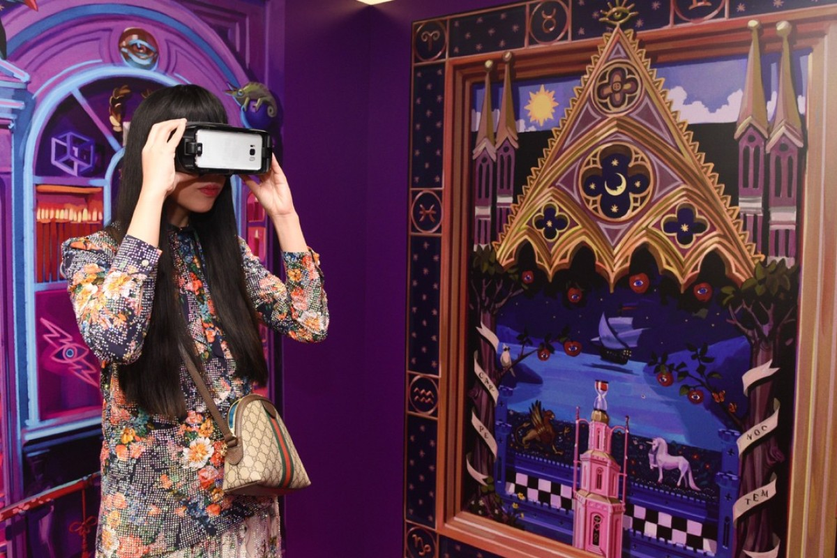 Susanna Lau tries out the VR experience at Gucci's party in Hong Kong