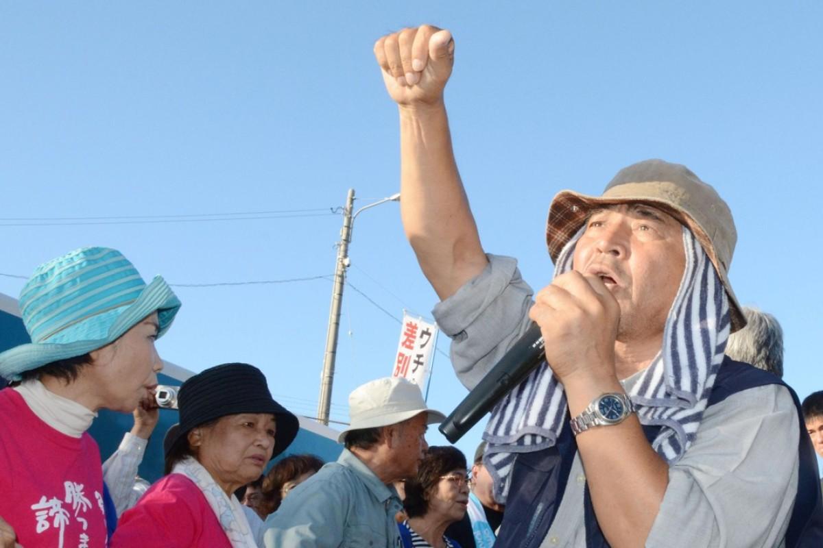 Hiroji Yamashiro rallying protesters outside the US military's Camp Schwab in Nago, Okinawa. Photo: Kyodo