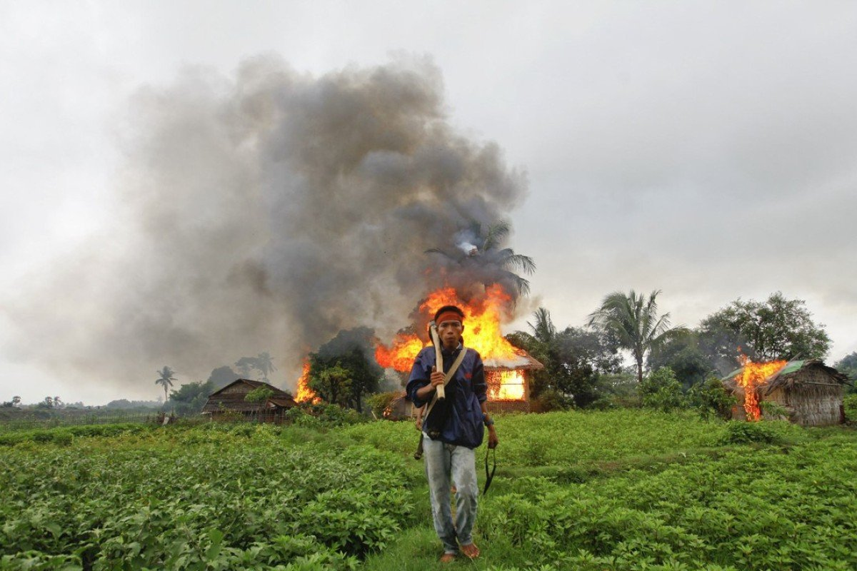A Buddhist Rakhine man walks away from houses torched during fighting between Rakhine and Muslim Rohingya communities in the Rakhine State capital of Sittwe. Picture: Reuters