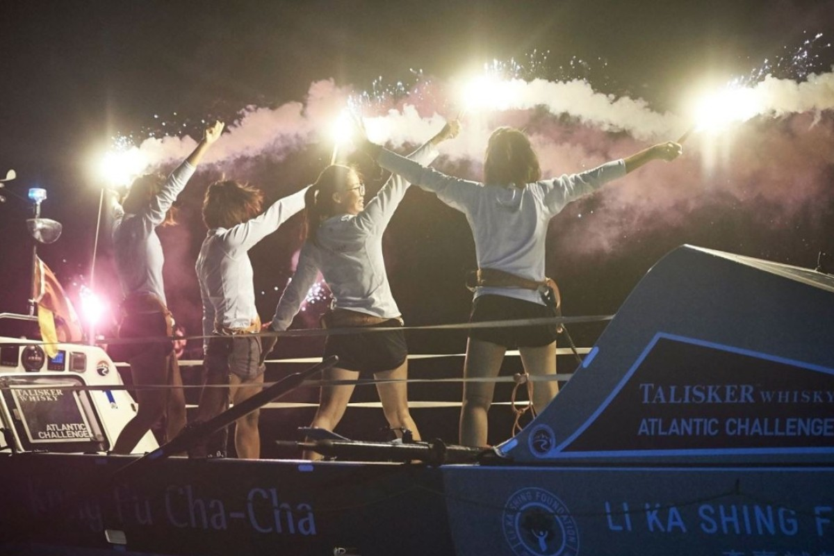 Kung Fu Cha Cha celebrate as they reach land. Photo: Atlantic Campaigns