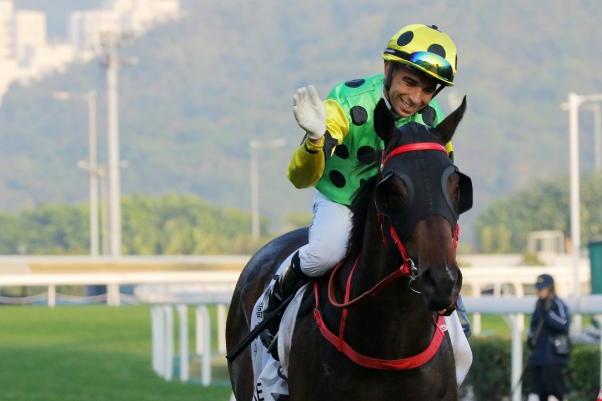 A delighted Joao Moreira gives Nothingilikemore a pat. Photos: Kenneth Chan