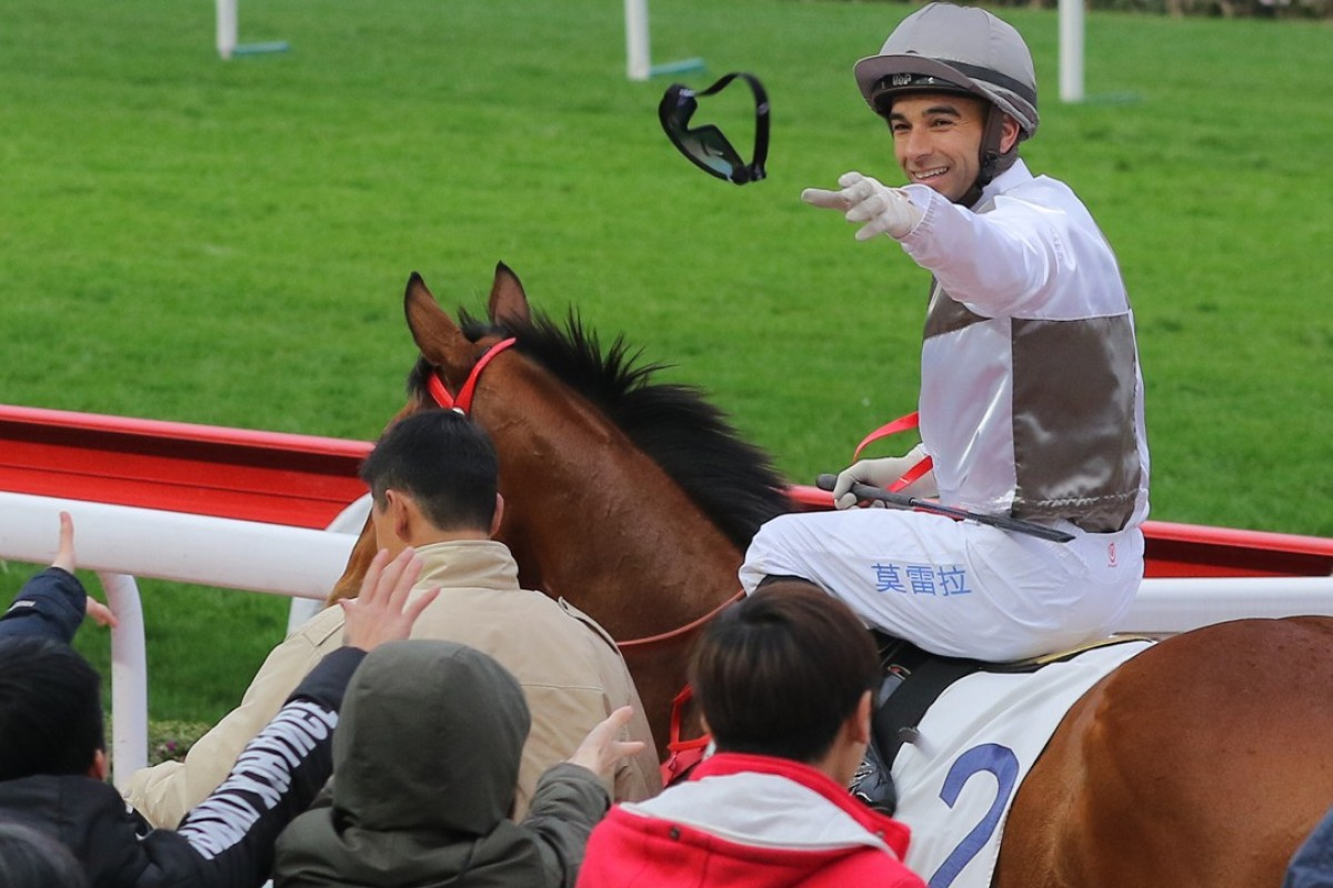 Joao Moreira throws his goggles to a fan after winning aboard Ivictory on Sunday. Photos: Kenneth Chan