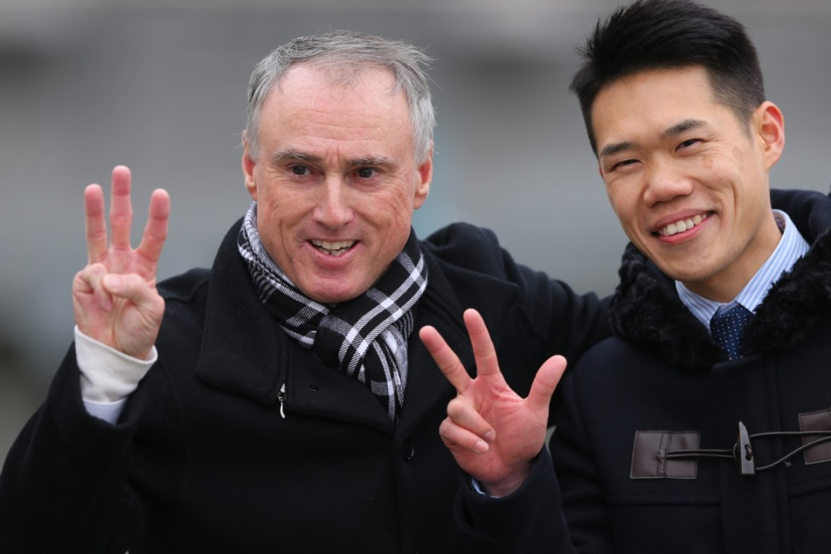 Paul O'Sullivan celebrates a treble with his assistant trainer. Photos: Kenneth Chan