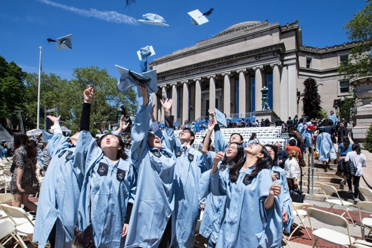 Chinese graduates throw their mortar boards into the air at Columbia University, in New York. Picture: Xinhua
