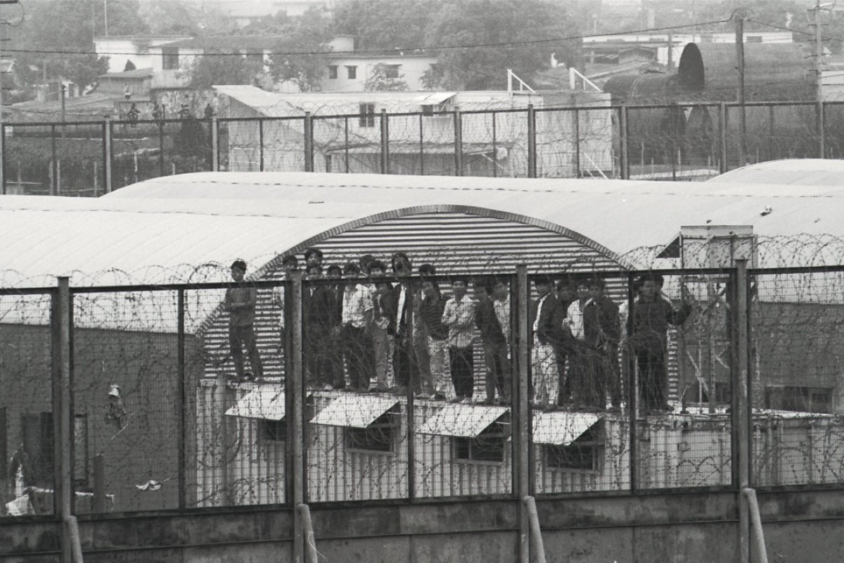 A group of Vietnamese boatpeople on a hut in the Sek Kong Detention camp after a fire killed 24 in 1992. Picture: SCMP
