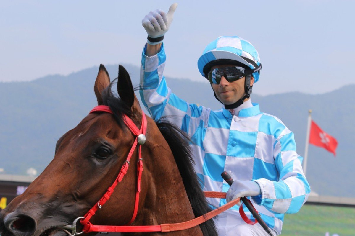 Joao Moreira gives the thumbs up after winning aboard Conte. Photos: Kenneth Chan