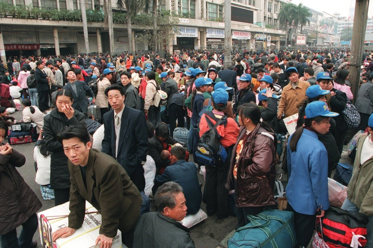Migrant workers at a train station in Guangzhou. File photo