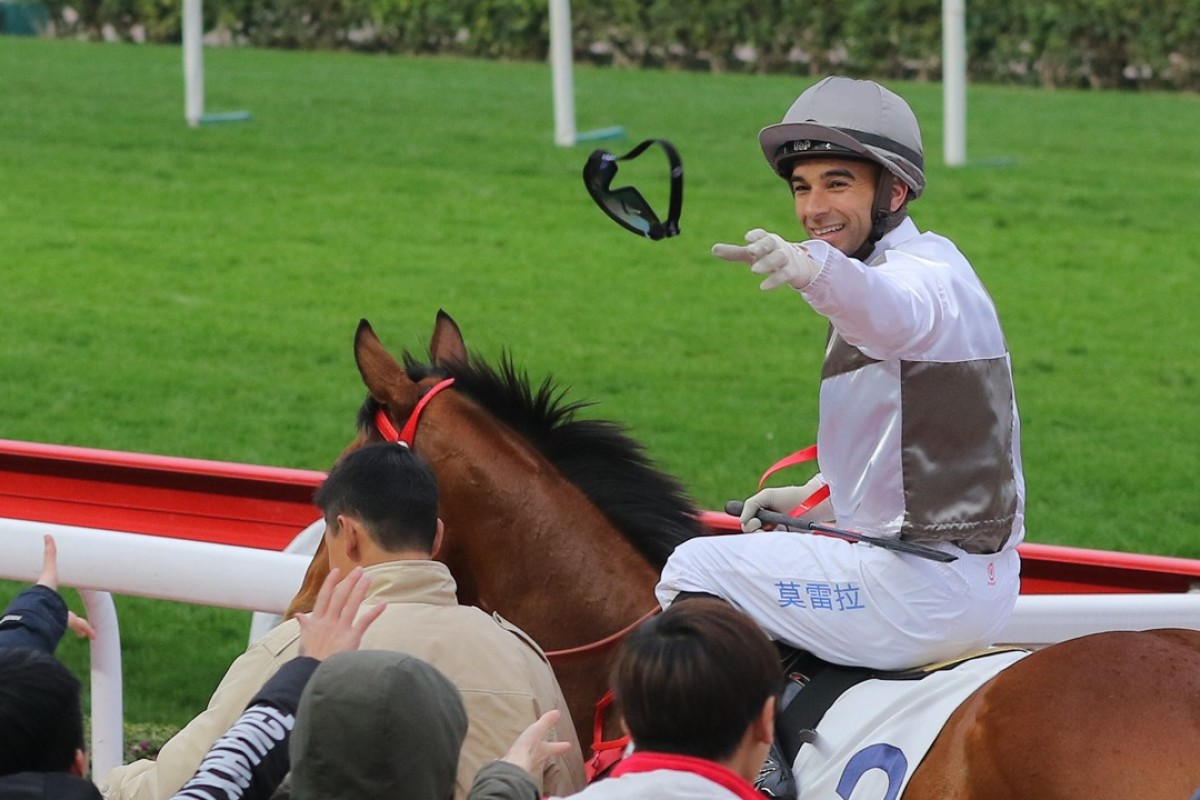 Joao Moreira throws his goggles into the crowd after winning on Ivictory on February 4 at Sha Tin. Photos: Kenneth Chan.