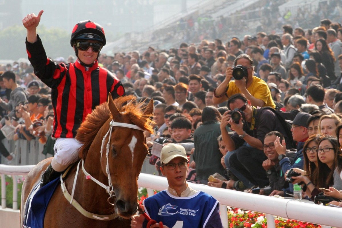 Zac Purton celebrates taking out the CITI Hong Kong Gold Cup on Time Warp. Photos: Kenneth Chan