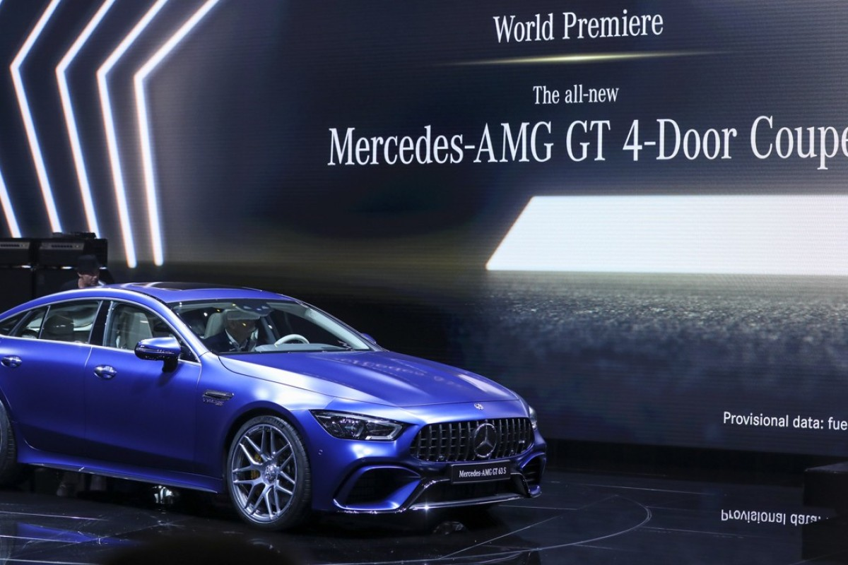 A Mercedes-AMG GT 4-Door coupe sits on display after its unveiling on the opening day of the 88th Geneva International Motor Show in Geneva, Switzerland. The show opens to the public on March 8, and will showcase the latest models from the world's top carmakers. Photographer: Chris Ratcliffe/Bloomberg