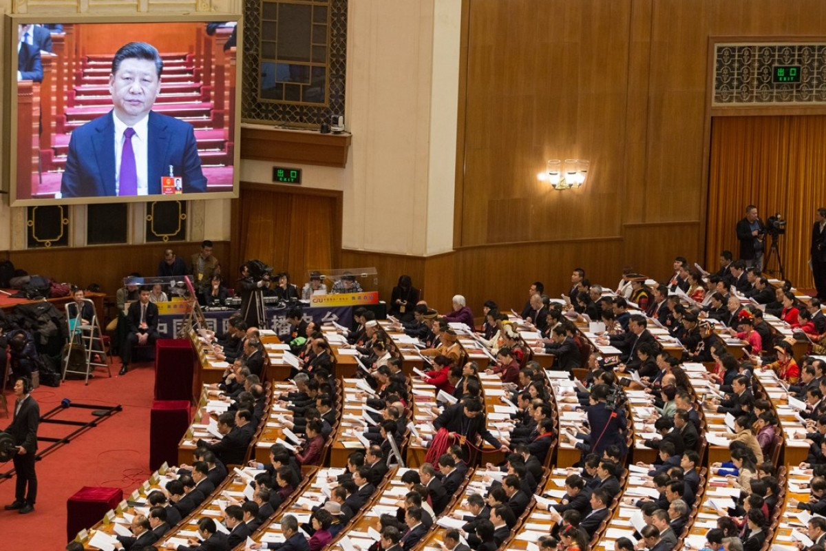 President Xi Jinping addresses delegates at the opening of the 13th National People's Congress at the Great Hall of the People in Beijing. Photo: EPA