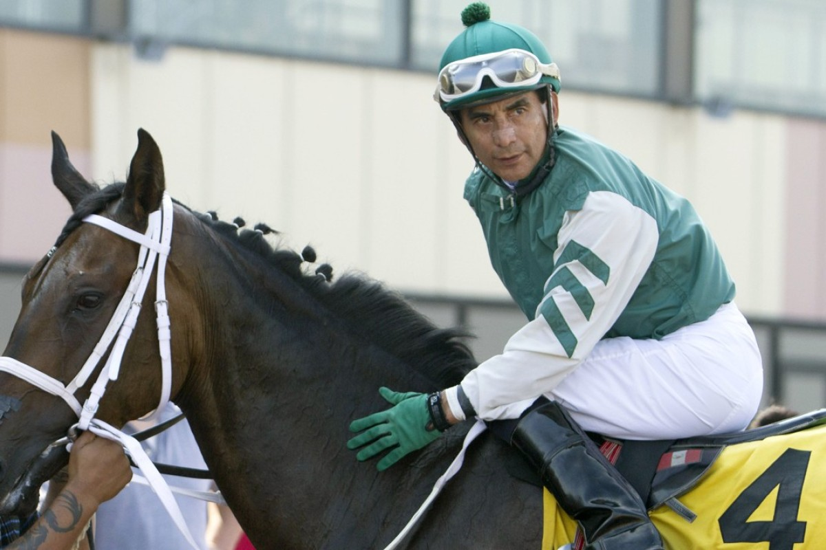 Jose Flores sits atop a race horse at Parx Racing. He was killed when he was thrown from a falling horse and suffered massive head trauma. Photo: AP