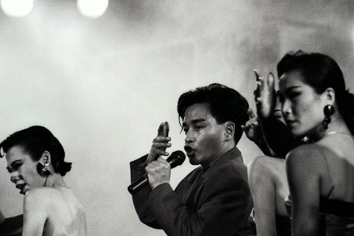 Canto-pop star Leslie Cheung Kwok-wing performs alongside dancers during a concert.