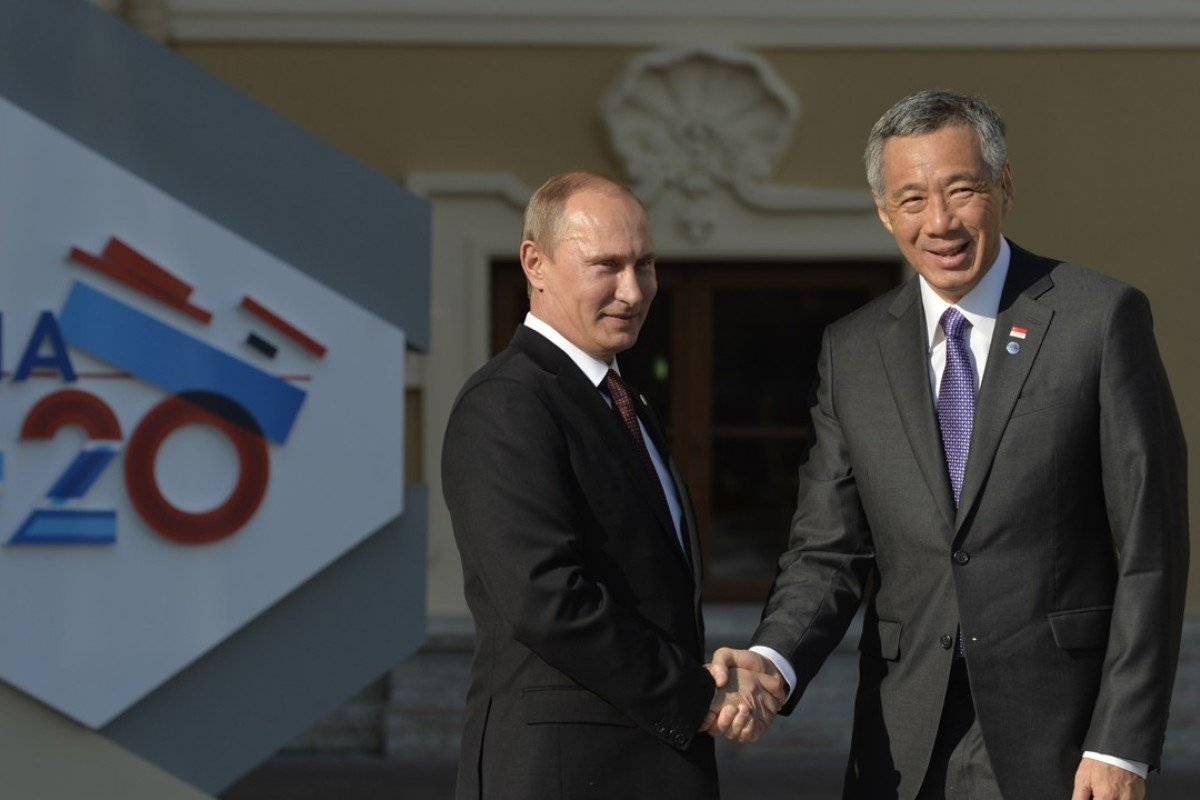 Russian President Vladimir Putin with Singapore's Prime Minister Lee Hsien Loong. Putin has reorientated his country's foreign policy towards Asia. Photo: AFP
