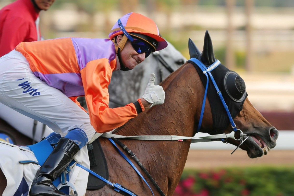 Douglas Whyte gives the thumbs up after winning with Royal Performer. Photos: Kenneth Chan