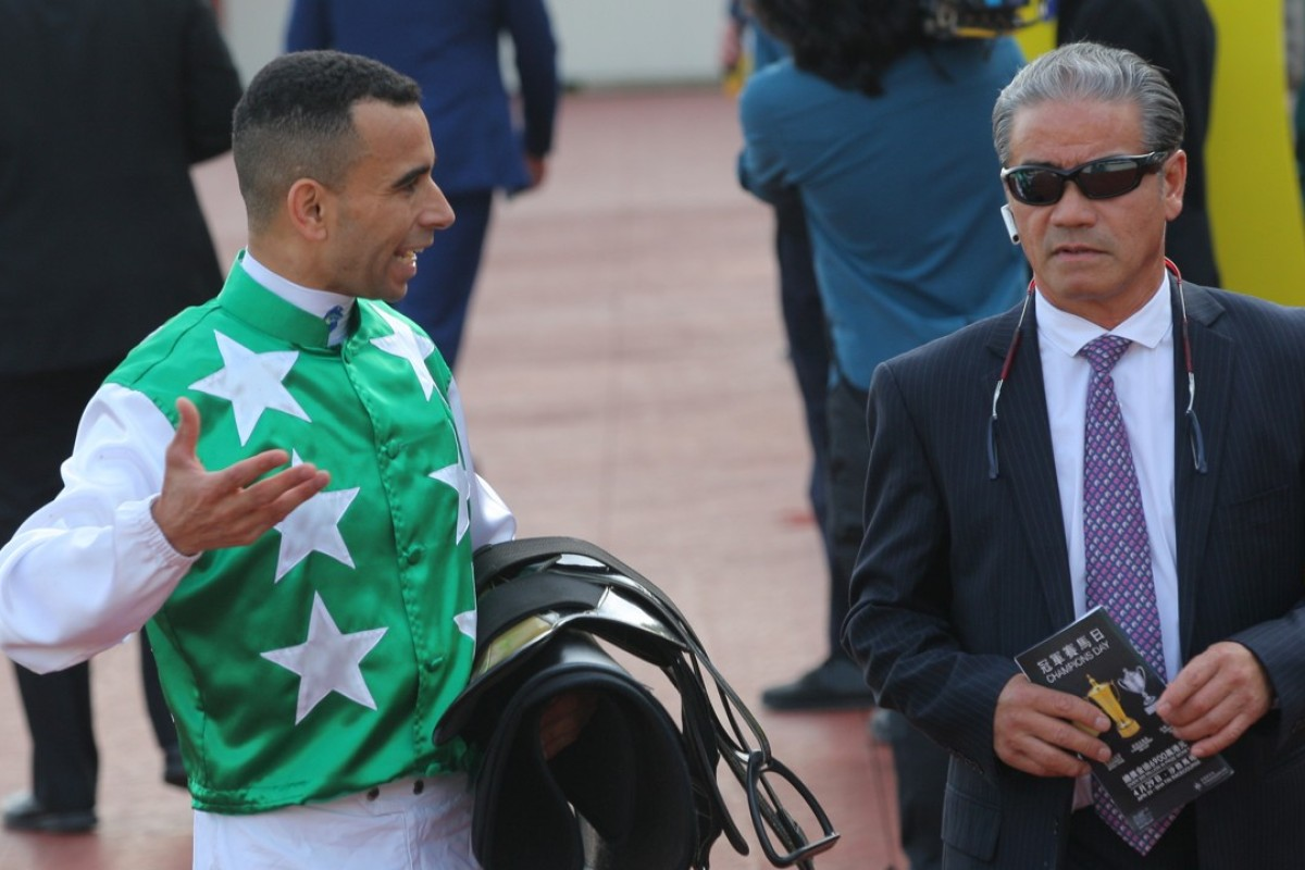 Joao Moreira talks to Tony Cruz after Pakistan Star finished fourth in the Chairman's Trophy. Photos: Kenneth Chan
