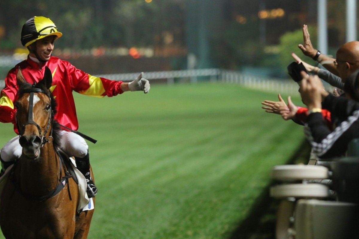 Joao Moreira gives the thumbs up to fans after winning with See Me Now in February. Photos: Kenneth Chan
