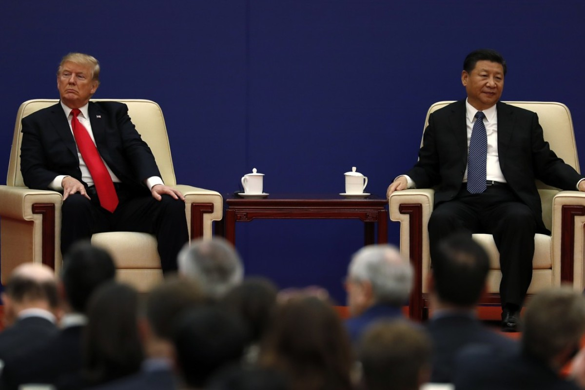 US President Donald Trump with Chinese President Xi Jinping at a business event at the Great Hall of the People in Beijing. Photo: AP