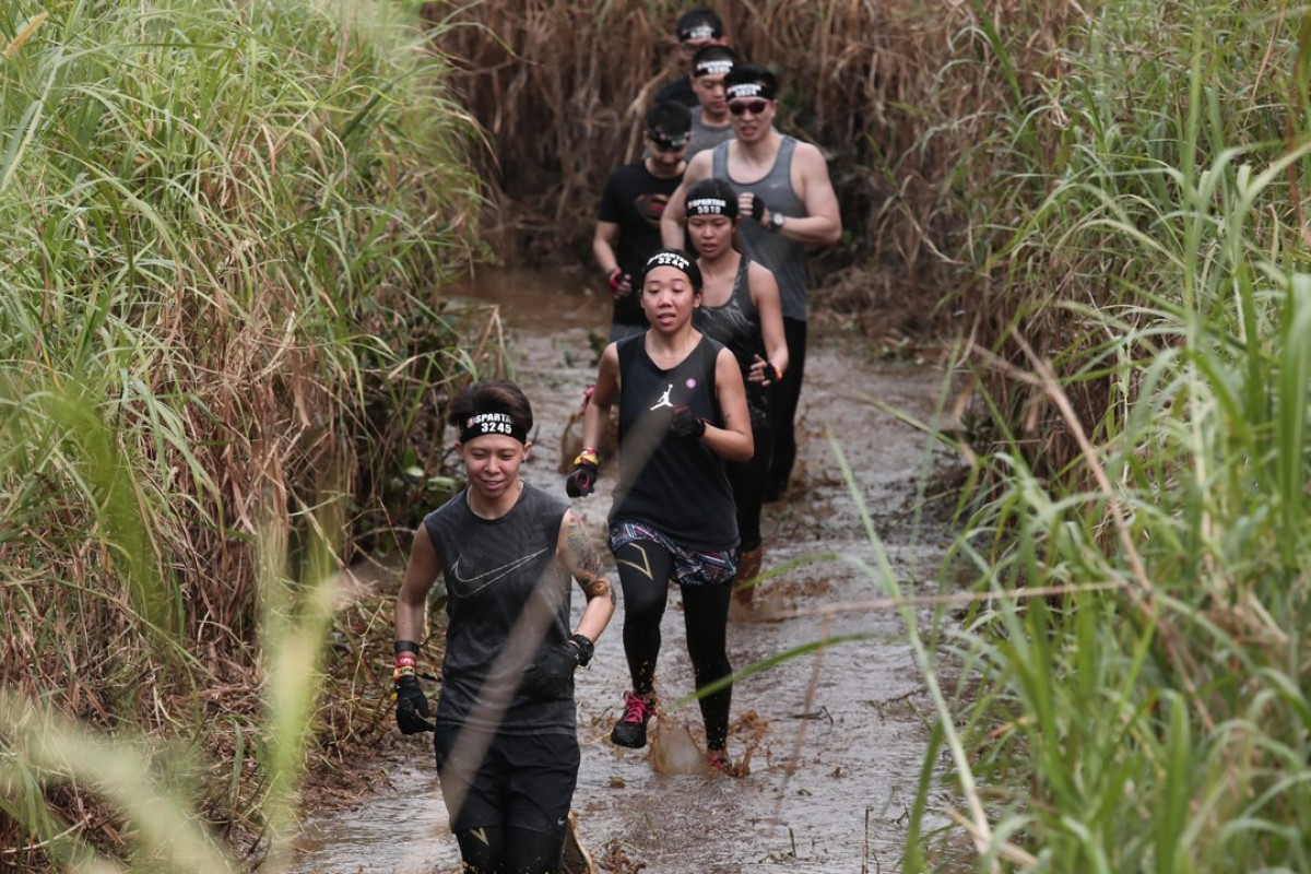 The Spartan Race starts with a run through mud. To our horror, we found out this did no count as one of the 20 obstacles. Photos: Jonathan Wong