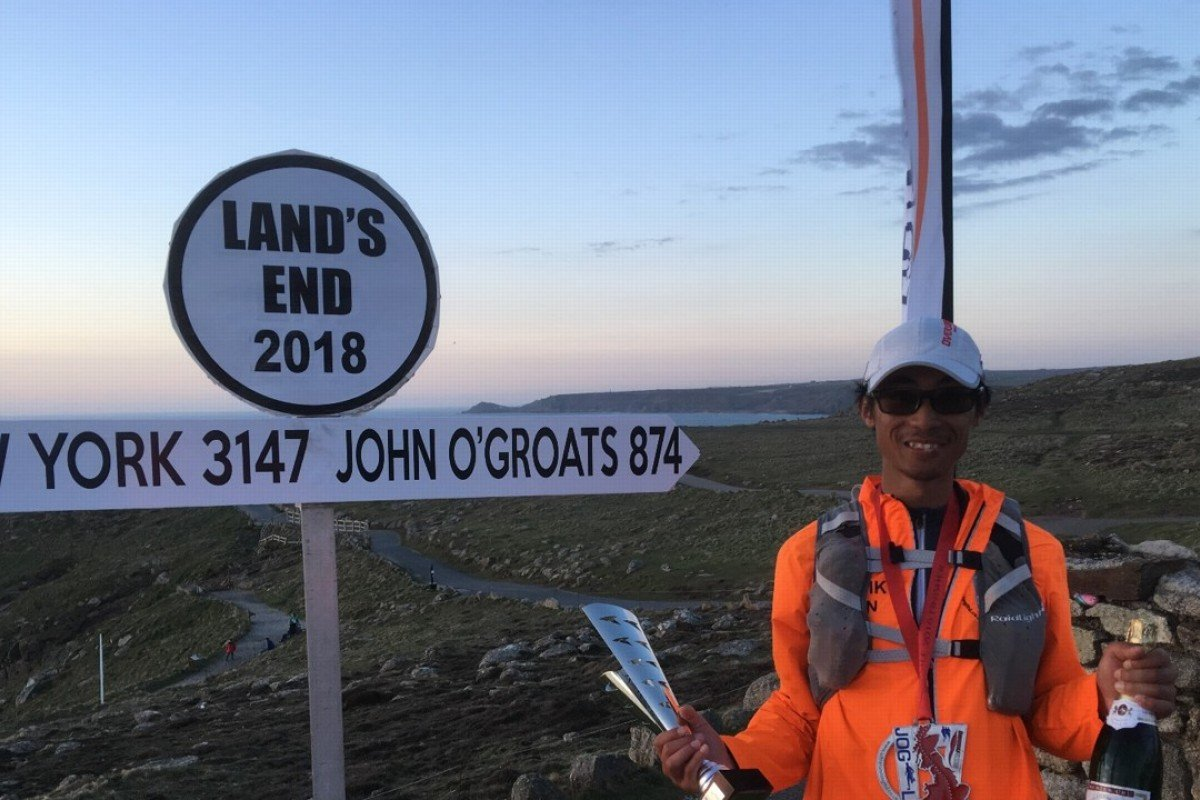 Kenneth Chan at Land's End in the UK, the finish line of his 1,300km run from John O' Groats. Photos: Handout