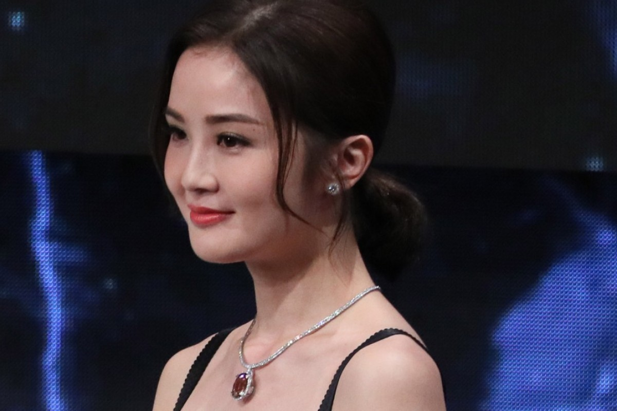 Hong Kong Film Awards ceremony host Charlene Choi looked stunning in Tiffany & Co earrings in platinum with diamonds. She also wore the maison's 'Vivid Dreams - The Extraordinary Color of Tiffany' necklace in platinum with a 31ct pink tourmaline.
