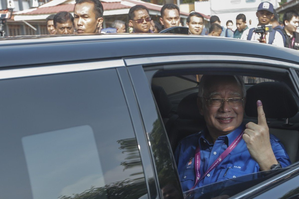 Malaysian Prime Minister Najib Razak after casting his vote. Photo: EPA