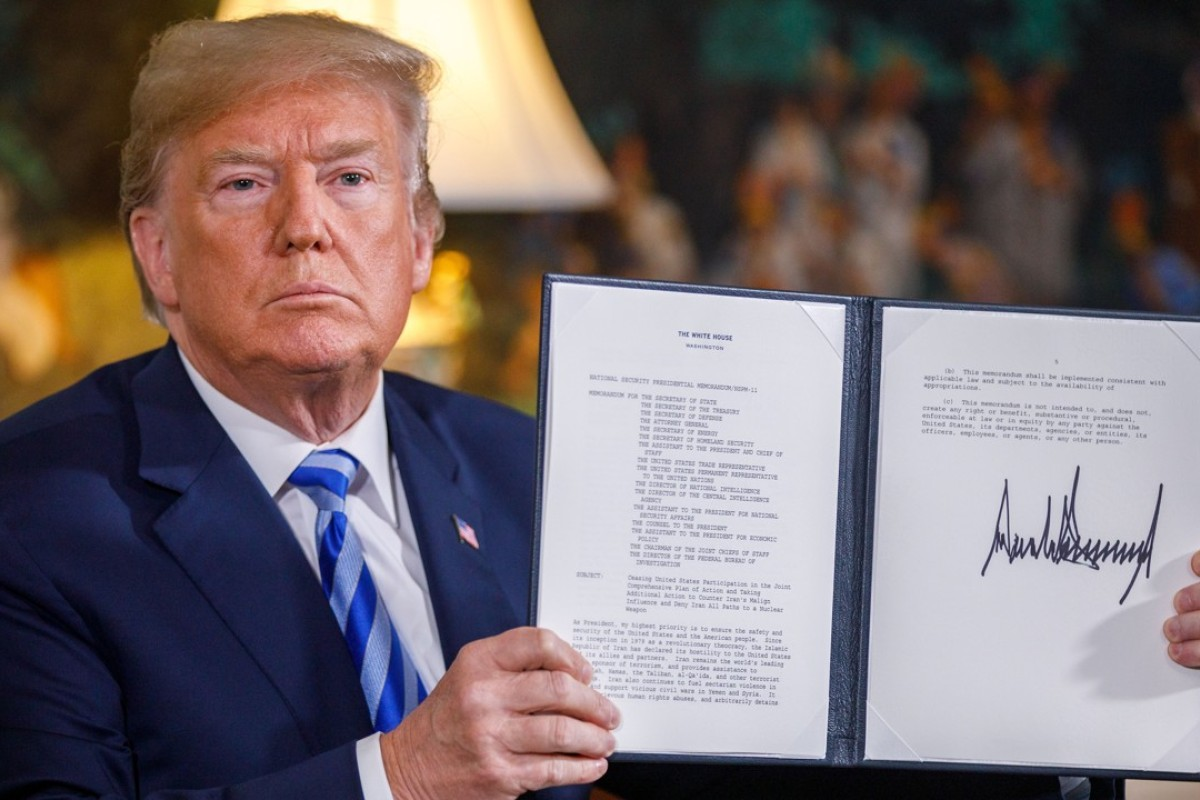 US President Donald Trump signs a memorandum declaring his intention to withdraw from the Iranian nuclear deal. Photo: Xinhua