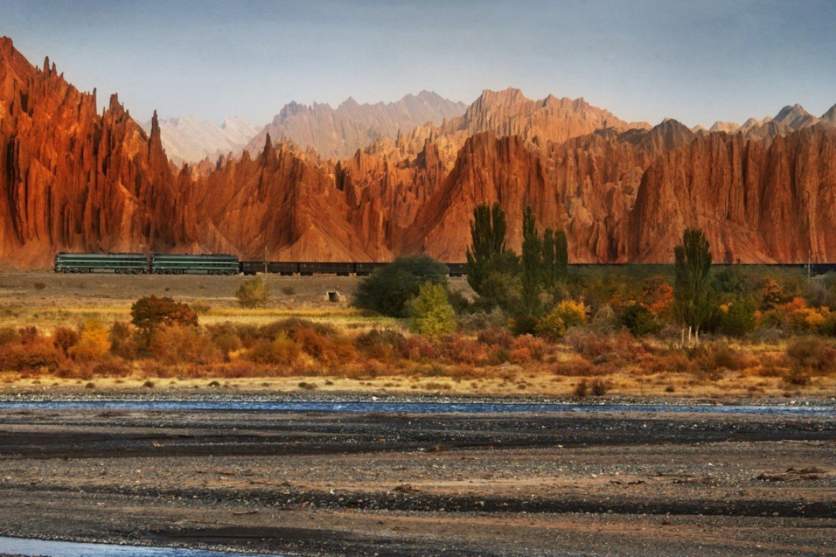 A goods train passing through the Tianshan Grand Canyon, in Xinjiang. Picture: Wang Wei