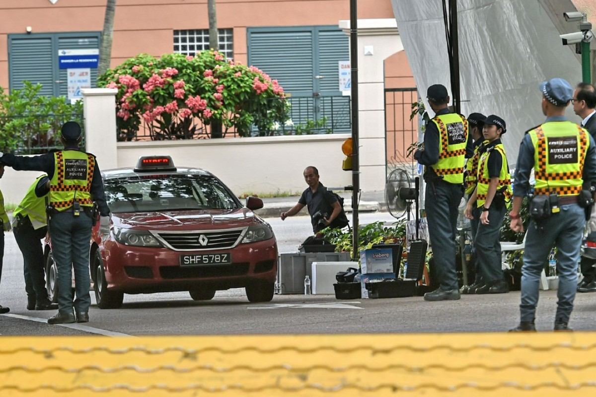 Vehicles entering the Shangri-La hotel in Singapore are checked by security personnel. Photo: AFP
