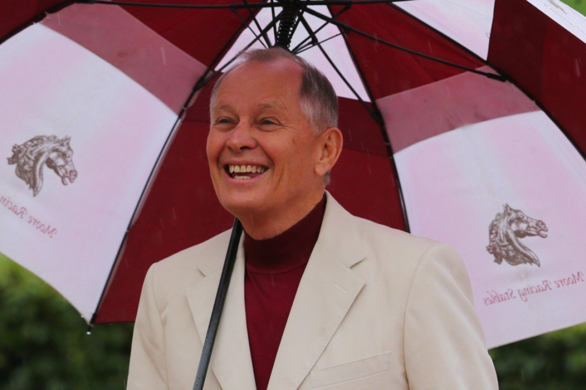 John Moore smiles in the rain. Photos: Kenneth Chan