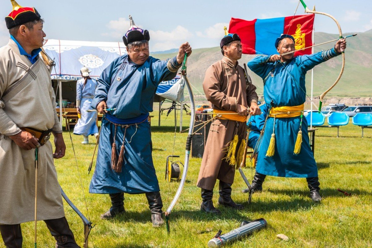 Archery during the Naadam Festival in the town of Bulgan. Picture: Alamy