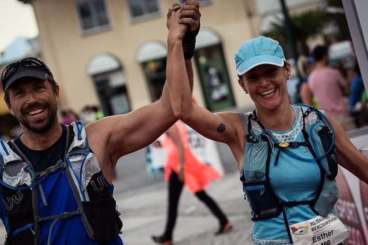 Paul Niel and Esther Roling finish the race around Lake Traunsee. Photo: Sportograf