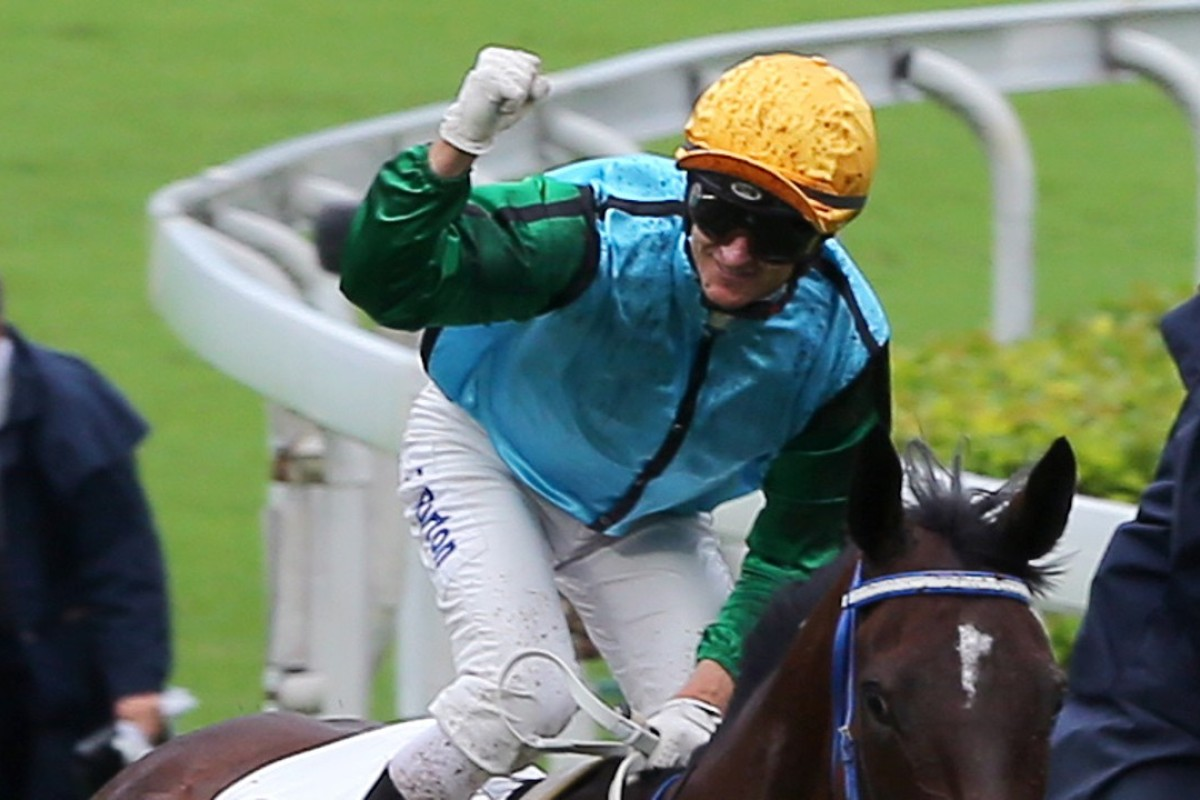 Zac Purton celebrates after clinching the jockeys' championship. Photos: Kenneth Chan