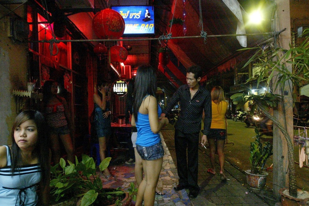 Bar girls wait for customers in Sungai Golok, in Thailand's southern province of Narathiwat, on the Malaysian border. Picture: AFP
