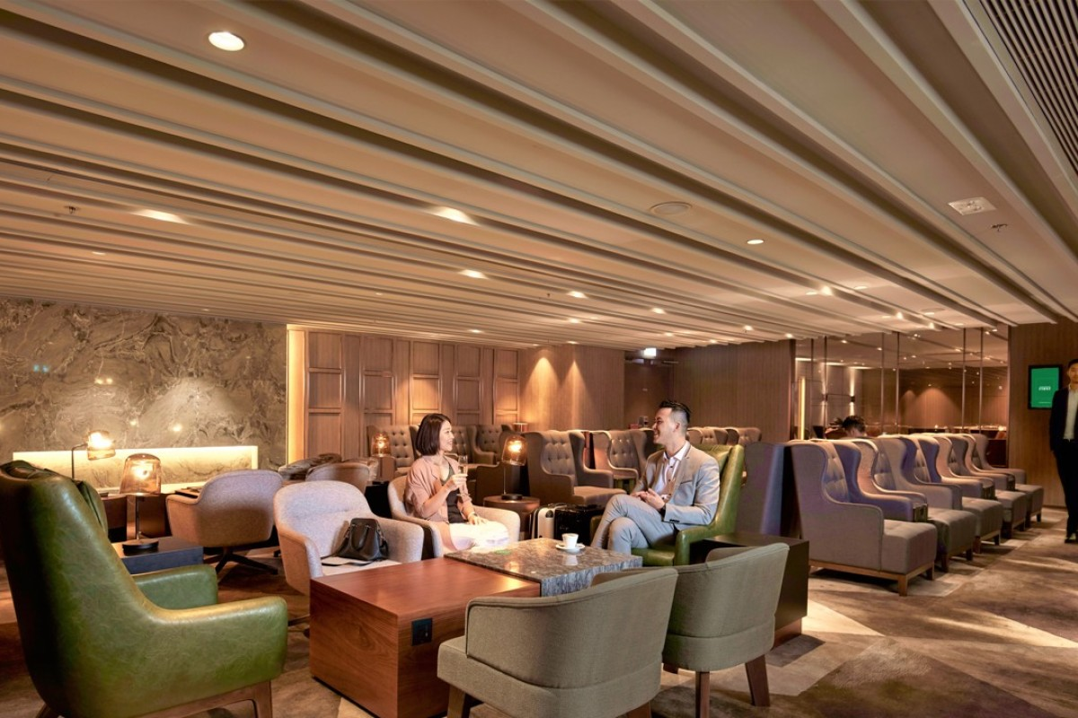 Relax with a drink in the elegant Plaza Premium First lounge.