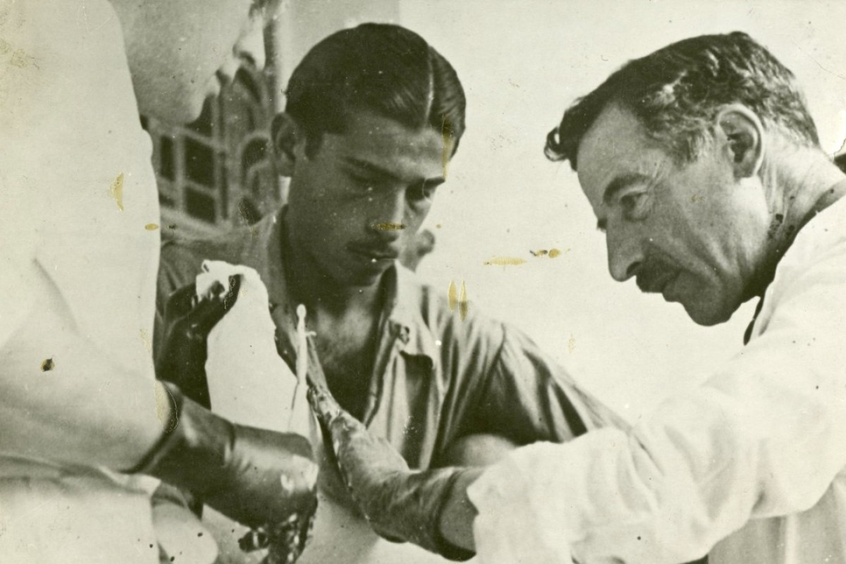 Dr Leo Eloesser (right) operating on a patient in Spain in 1937, at the height of the Spanish civil war. Picture: courtesy of the Tamiment Library, New York University