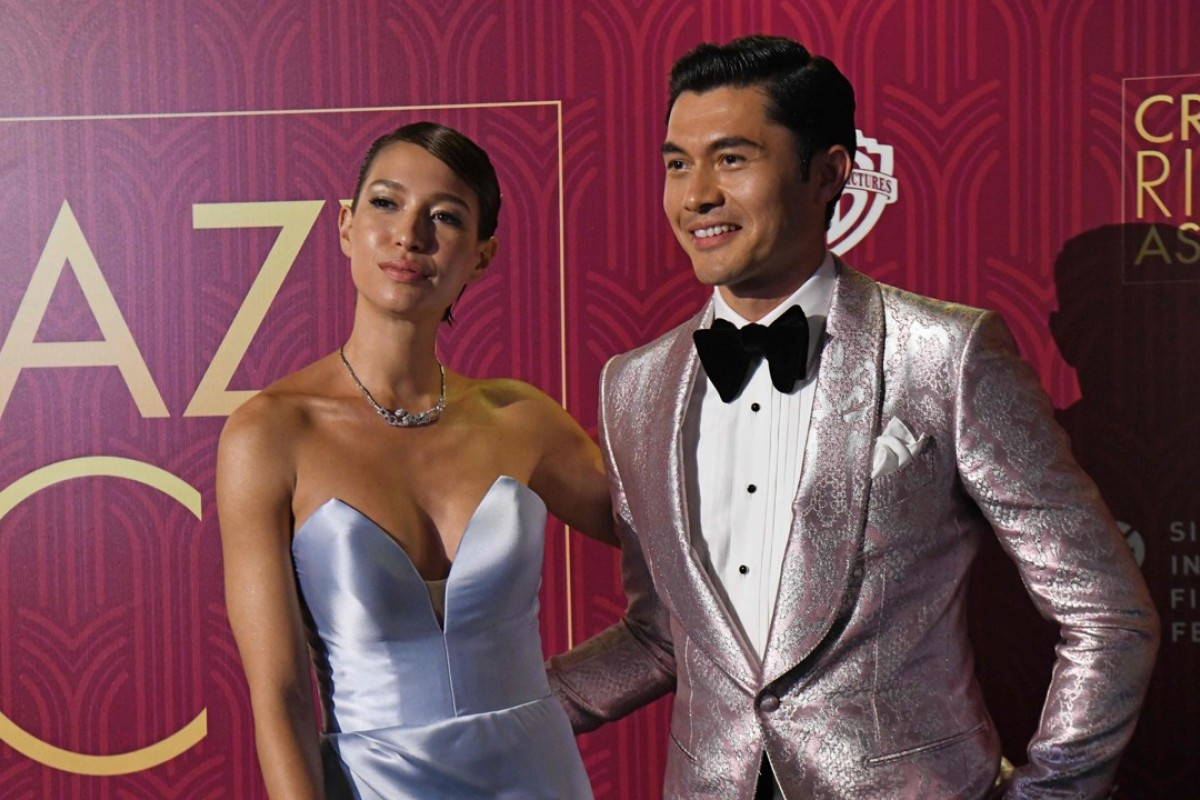 In 'Crazy Rich Asians' (starring Henry Golding, above), the super-rich drive supercars and party till the wee hours of morning. But actual billionaires in Singapore do not lead such a lifestyle. Photo: AP