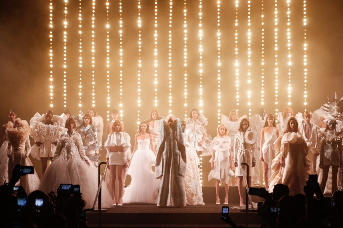 Models in white gather on stage at the end of Viktor & Rolf's autumn/winter haute couture show. Photo: Peter Stigter