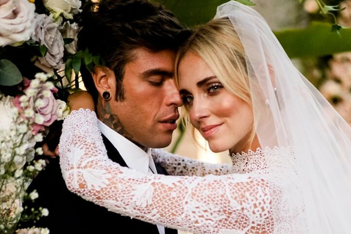 The Italian couple of fashion blogger Chiara Ferragni – wearing a Dior wedding dress – and her rapper husband, Fedez, embrace after their marriage in Sicily, Italy, on September 1. Photo: David Bastianoni