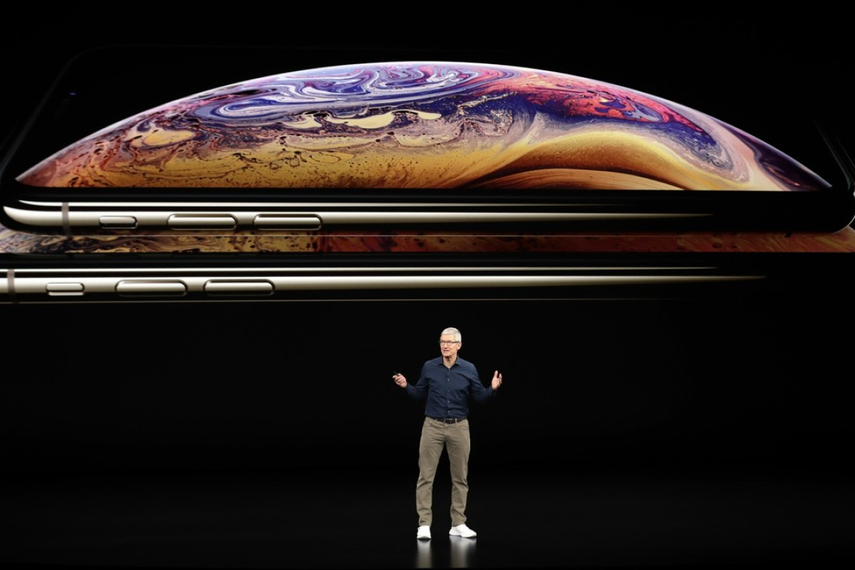 Apple CEO Tim Cook announced new iPhone models, aimed at widening the product's appeal amid slowing sales, at the Steve Jobs Theater in Cupertino, California yesterday. Photo: Marcio Jose Sanchez/AP