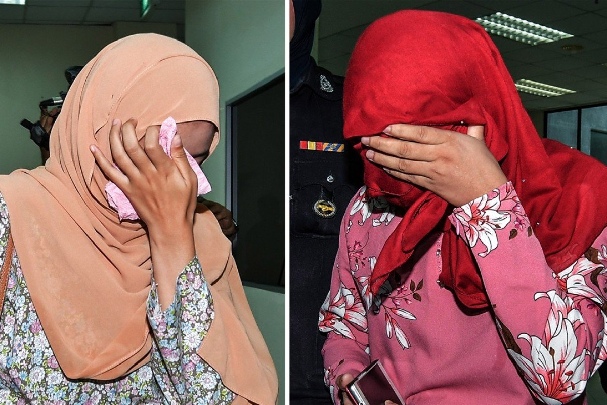Two Malaysian women who were caned in public after admitting lesbian sex. Photo: EPA
