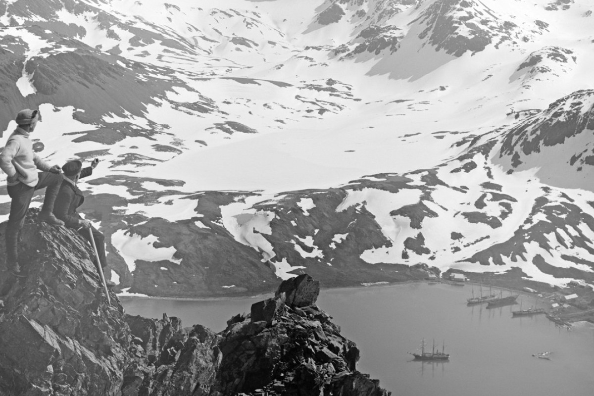 Frank Worsley and Lionel Greenstreet looking across South Georgia harbour. Ernest Shackleton's ship, 'The Endurance', is in the bay below. Frank Hurley's famous photos will be on display this Friday in Central, Hong Kong. Photo: RGS-IBG