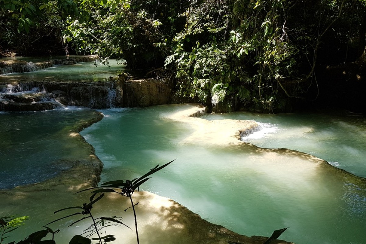 The rich green hues of the gently flowing cascades at Kuang Si Falls. Photos: Cedric Tan