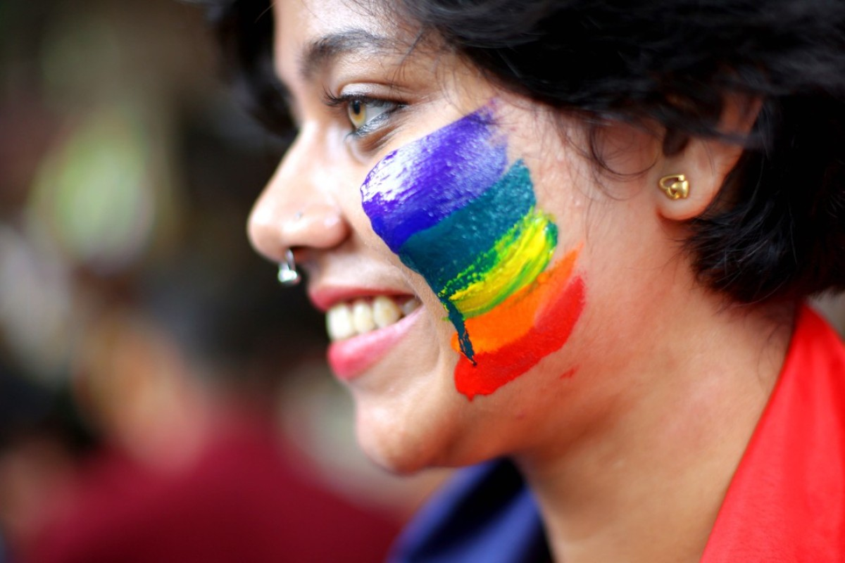 An LGBTI activist celebrates India's overturning of a law criminalising gay sex. The Indian court's verdict has inspired campaigners seeking a similar move in Singapore. Photo: EPA