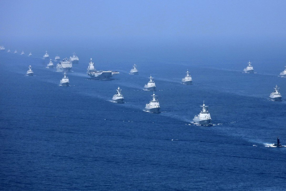 A Chinese fleet accompanies its aircraft carrier the Liaoning in the South China Sea. Photo: AP