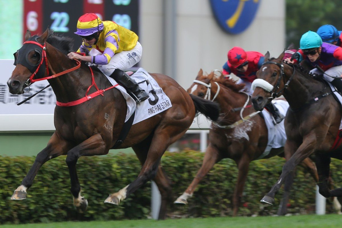Ryan Moore guides Ping Hai Star to victory in the Hong Kong Derby. Photos: Kenneth Chan