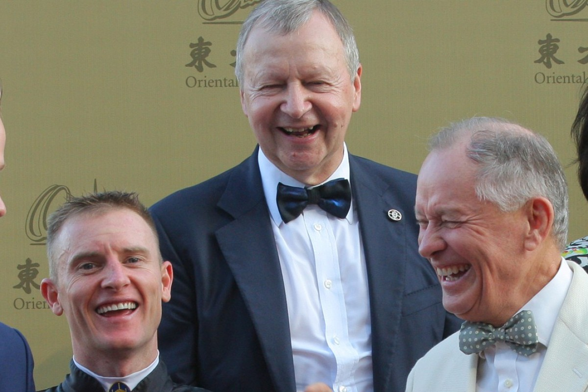 Zac Purton (left) and John Moore (right) share a laugh with Jockey Club chief executive Winfried Engelbrecht-Bresges (middle). Photo: Kenneth Chan
