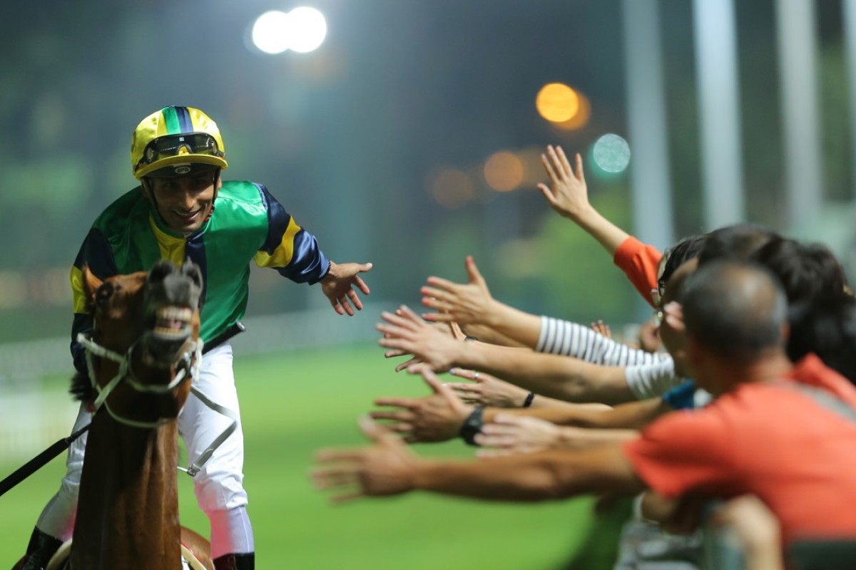 Karis Teetan high fives fans after a win at Happy Valley on Wednesday night. Photos: Kenneth Chan