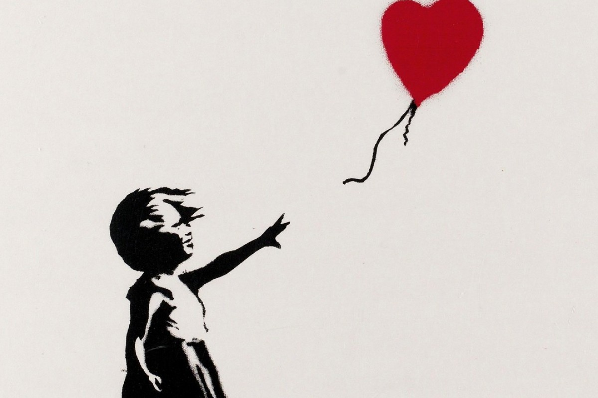 A framed copy of Banksy's famed 'Girl with Balloon' from 2004 was spontaneously shredded during an auction using a mechanical device the artist had hidden in the frame.
