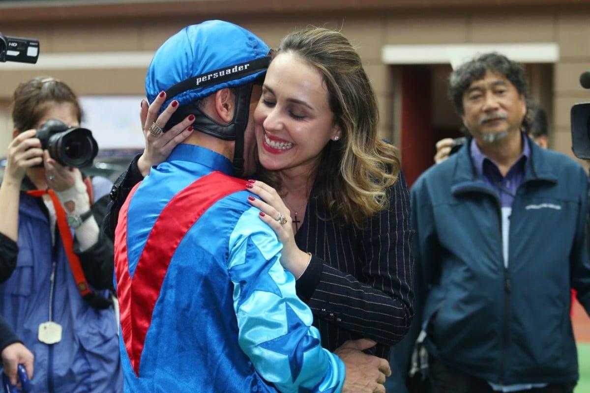 Joao Moreira hugs wife Taciana after winning the 2017 Hong Kong Derby. Photos: Kenneth Chan